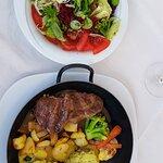 Medium pork steak 2 x with green pepper, 2 x mustard sauce, baked potatoes, vegetable, mix salad
