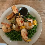 Scampi Skewers over minted peas and scalloped potatoes.