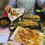 Miso aubergine, spicy tuna sushi, kimchi fries, sake, karaage squid and bbq'd prawns
