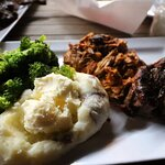 Steak, pulled pork, mashed potatoes, and broccoli
