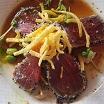 I enjoyed the Seared Ahi Tuna with Seaweed Salad and Edamame. That's not cheese; it had a crunch