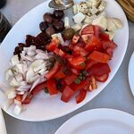 The 11.75 Euro platter. Rather small and predominantly raw chopped onions and tomatoes. Coming f