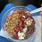 The purple bowl.... topped with granola, goji berries, almonds, and cacao nibs. YUM!