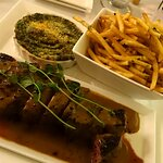 Steak Au Poivre - served with cream spinach and french fried potatoes - Sauce needed a bit more