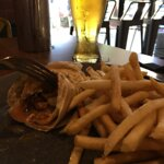 pork wrap and chips and beer