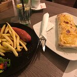 Burrito and a sausage with French fries