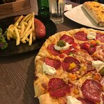 Pizza with local cheese and other ingredients. Delicious
