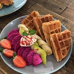 Waffles served with fresh fruits.