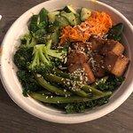 My custom bowl of spinach, kale, sriracha string beans, garlic broccoli Thai cucumbers, French c