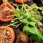 Side dish of garlic and rosemary potatoes, mushrooms and tomatoes