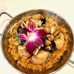 Grouper, with shrimp, scallops, mussels, clams over seasoned rice! A wonderful version of paella