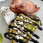 Smashed Avo on sourdough toast and poached egg and bacon
