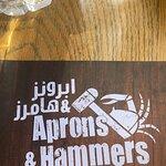 صورة فوتوغرافية لـ Aprons & Hammers