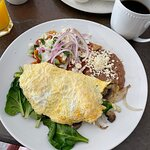 Veggie omelets stuffed with spinach and tomatoes served with your choice of beans or country pot