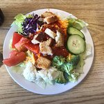 A very large salad prepared by our server per our I instructions and she did an excellent job. C