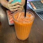 Iced tea. I would call this iced milk tea (or Thai style iced milk tea). I didn't expect milk in
