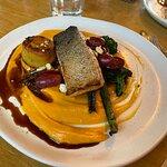 Crispy skin Ora Salmon Fillet with Kumara puree, fondant potato, grape agrodolce, charred brocco