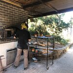 The bread oven with the baker who has been there 10 years.