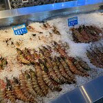صورة فوتوغرافية لـ Seafood Market