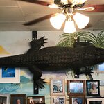 We sat near the alligator on the wall