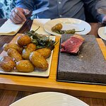 Hot stone to cook meat to taste
