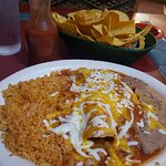 Seafood enchilada with a white, cheese sauce? (It wasn't, it was served with a red sauce.)