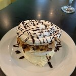 Hansel Kisses. Meringue with coffee cream covered with toasted almonds. Delicious!