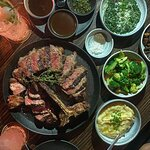 food: USDA 900g PORTERHOUSE, creamed spinach, roast garlic mashed potatoes, broccoli, sautéed mu