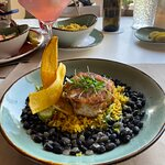 Seared grouper w/ black beans & yellow rice. The Siren cocktail is in the background...amazing d