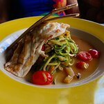 you are looking at a grilled Snapper, with Pasta, Zuccini, Onions, Cherry Tomatoes,.