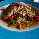 this delicious dish is a grilled Yellow Tail..with Pasta, Zucchini , Onions, Cherry Tomatoes, an