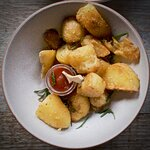Duck Fat Roast Potatoes with homemade tomato sauce and Rosemary