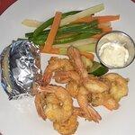 Breaded shrimp with potato, veggies and tartar sauce