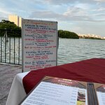 Menu of the day and view of lagoon.