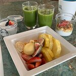Fruit with green juice and yoghurt and tapioca.