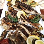 Grilled white sea fish platter with olive oil and local herbs. The taste is phenomenal and it is