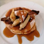 Excellent banana & crispy bacon pancakes with lashings of maple syrup. What's not to love?!