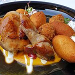 Toasted rabbit with liver crisp, vegetable cream sauce, and potato donuts