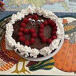 Chocolate Torte with raspberries and whipped cream for 60th Birthday.
