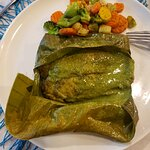 African Smoked Grouper in banana leaf