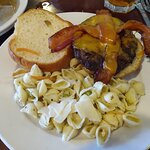 Burger with pasta salad.