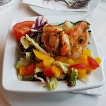 Delicious grilled shrimp on mixed salad