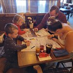 Family day out.. sat with a table of children colouring in the sheets provided and yes. The 2 ad