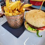 Veggie burger and chips.