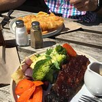 A slice of BBQ aubergine with potatoes and veg £14 and the fish & chips