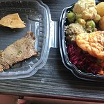 Mixed meat & a lot of roast potatoes . Some vegetables