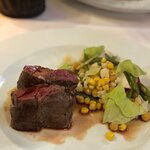 Lamb chop with warm vegetable salad