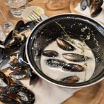 Unopened Mussels in curdled sauce
