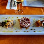 Octopus salad on smoked swordfish, smoked sea bass and shrimps...