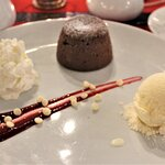 Hot molten lava chocolate cake with ice cream and whipped cream. Fabulous!